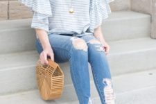 With beige heels, unique bag and distressed jeans