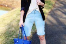With beige shirt, black blazer, platform shoes and cobalt blue tote