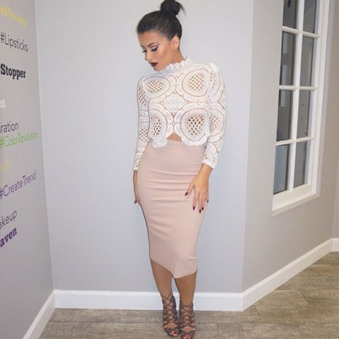 With biege skirt and gray lace up shoes