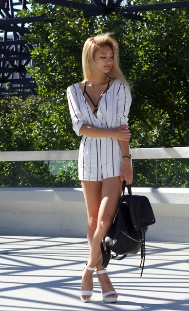 With black backpack and white platform sandals