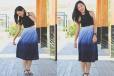 With black crop top and black flat sandals