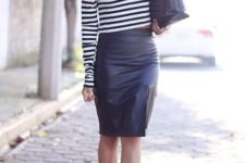 With black leather skirt, high heels and black bag