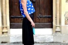 With black midi skirt, blue sandals and clutch