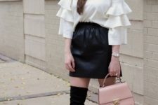 With black mini skirt, over the knee boots and pale pink bag
