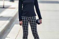 With black shirt, checked pants, clutch and pumps