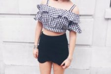 With black shorts and lace up flats