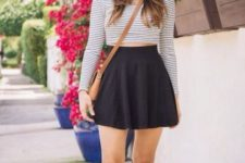 With black skater skirt, wide brim hat, brown flats and crossbody bag