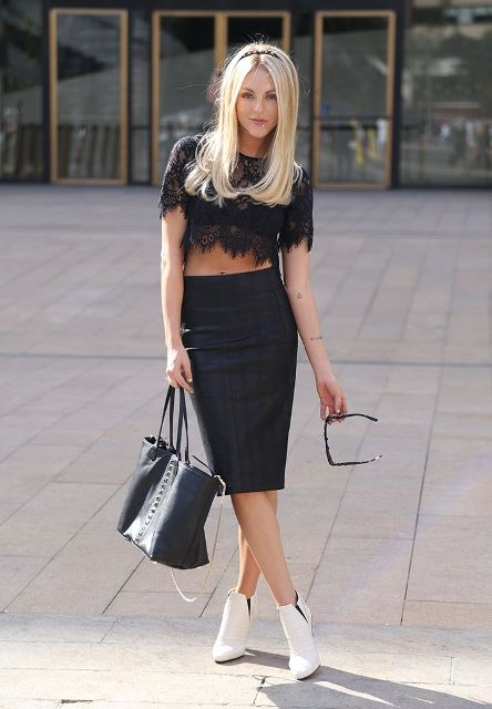 With black skirt, black tote and white ankle boots