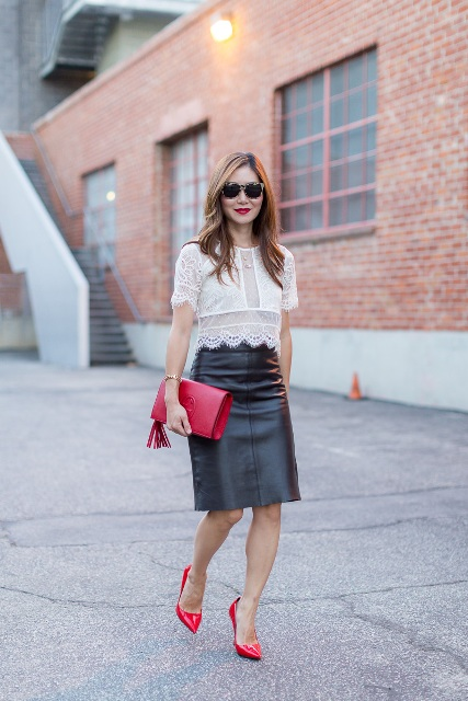 With black skirt, red clutch and red pumps