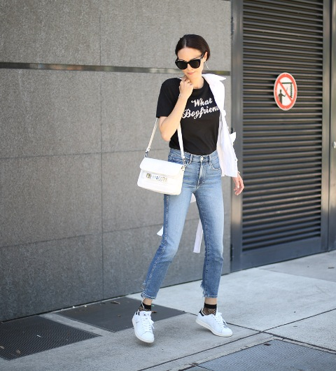 With black t shirt, crop jeans, white sneakers, white jacket and bag