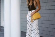 With black top, yellow bag and lucite heels