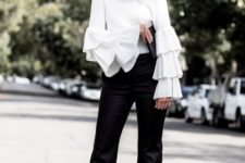 With black trousers and black pumps