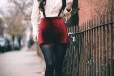 With blouse, black tights, brown lace up boots and wide brim hat