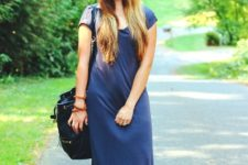 With blue maxi dress and black bag