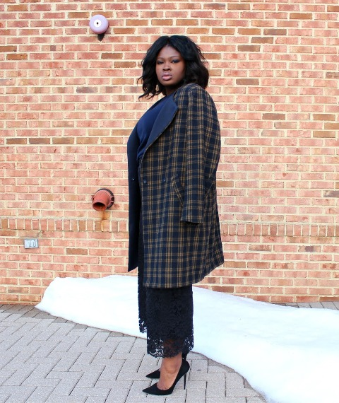 With checked coat and black pumps