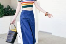 With denim culottes, yellow sandals and black leather bag