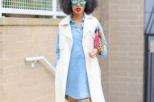 With denim dress, clutch and beige and black shoes