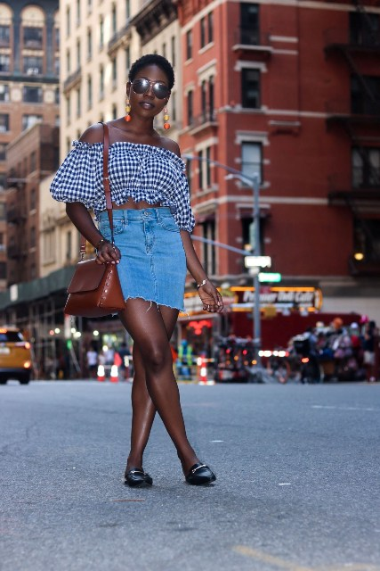 With denim mini skirt, black flat shoes and brown bag