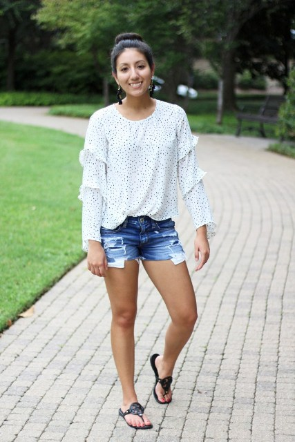 With denim shorts and black flat sandals