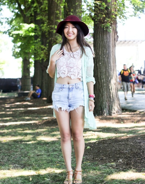With denim shorts, wide brim hat and mint green cardigan