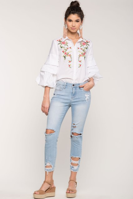 With distressed jeans and platform sandals