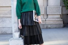 With emerald sweatshirt and black shoes