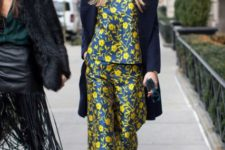 With floral blouse, navy blue coat and red boots
