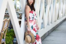 With floral crop top, white shoes and wide brim hat