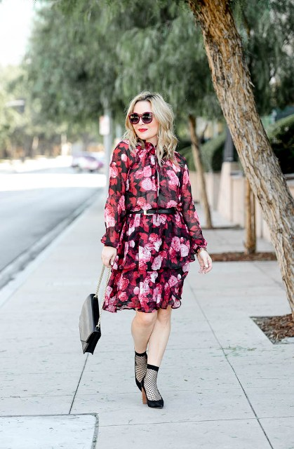 With floral dress, black shoes and black bag