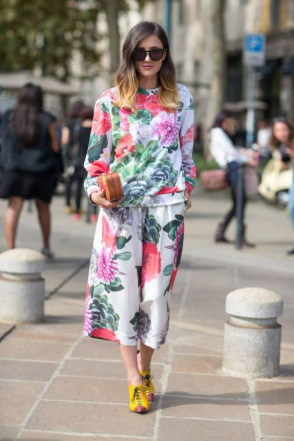 With floral sweatshirt, yellow shoes and mini clutch