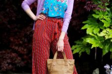 With floral top, lilac jacket, gray sandals and brown bag