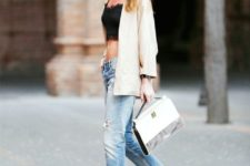 With jeans, beige blazer, black heels and white bag