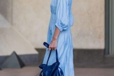 With light blue dress, blue bag and sneakers