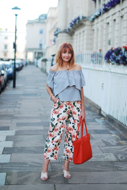 With light blue off the shoulder blouse, beige mules and red tote