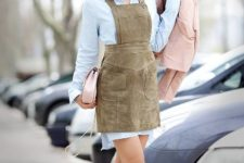 With light blue shirtdress, sneakers, light pink jacket and clutch