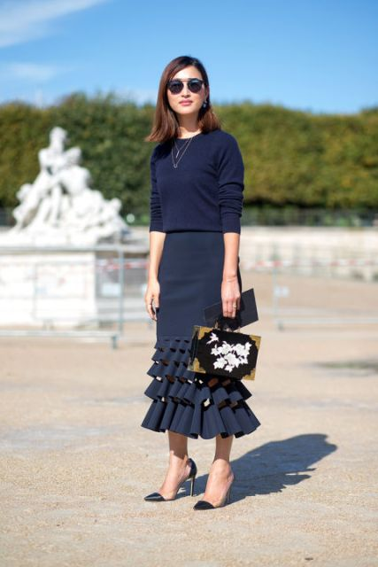 With navy blue shirt, bag and pumps