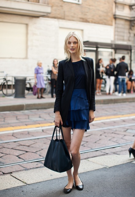 With navy blue shirt, black blazer, black flats and tote