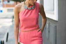 With necklace and golden clutch
