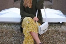 With olive green shirt, platform shoes and white bag