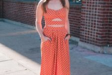 With orange polka dot top and brown flat shoes