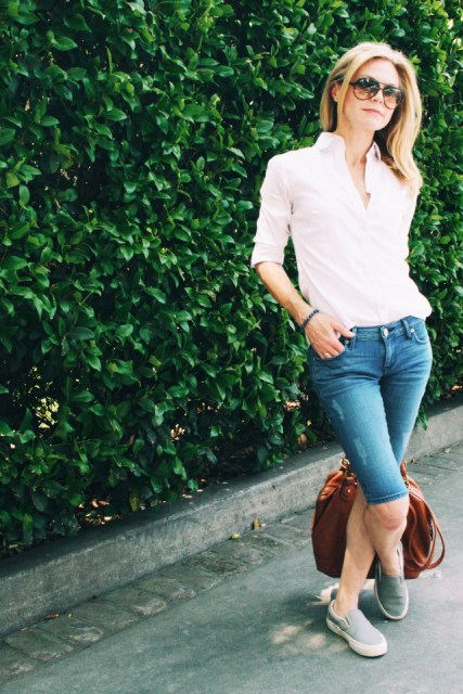 With pale pink shirt, flats and brown bag