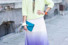 With pastel colored sweatshirt, silver pumps and small clutch