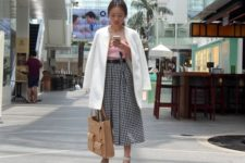 With pink crop top, white long blazer, white sandals and beige tote