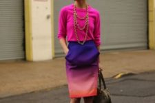 With pink shirt, pink pumps and gray tote