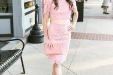 With pink skirt, lace up sandals and pale pink clutch
