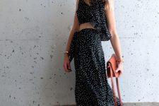 With polka dot shirt, brown bag and brown leather heels