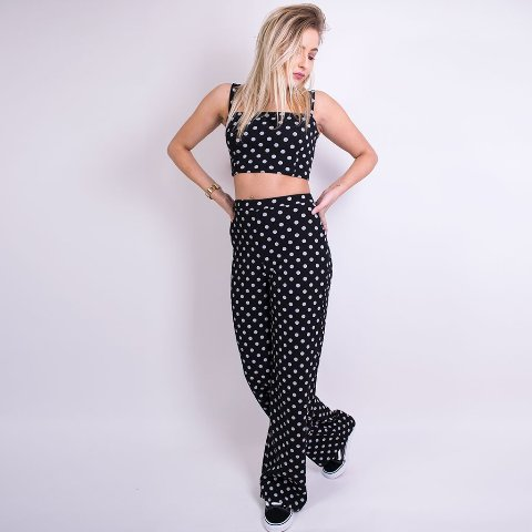 With polka dot wide leg pants and sneakers
