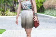 With printed t-shirt, red flats and brown bag