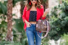 With red blazer, distressed jeans, lace up sandals and printed bag