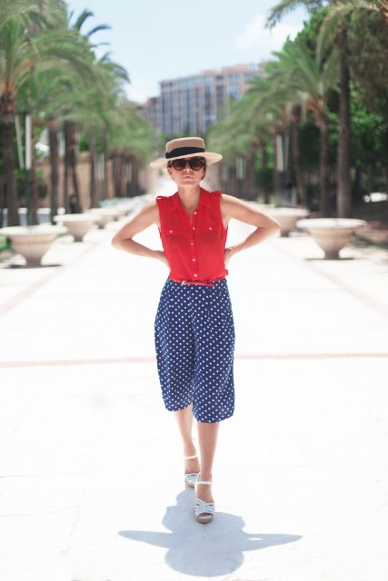 With red shirt, wide brim hat and white sandals